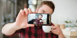 5-web3-man-selfie-phone-photo-coffee-cafe-shutterstock